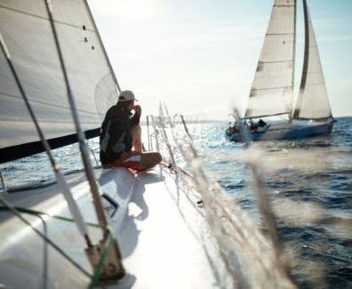 young-handsome-man-relaxing-on-his-sailboat-EA7SBYR_web